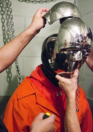 Prisoner in bondage hoods
