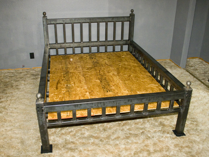 the bed disassembles into four parts for transportation the steel bed frame weighs around 350 pounds before mattress and sheets